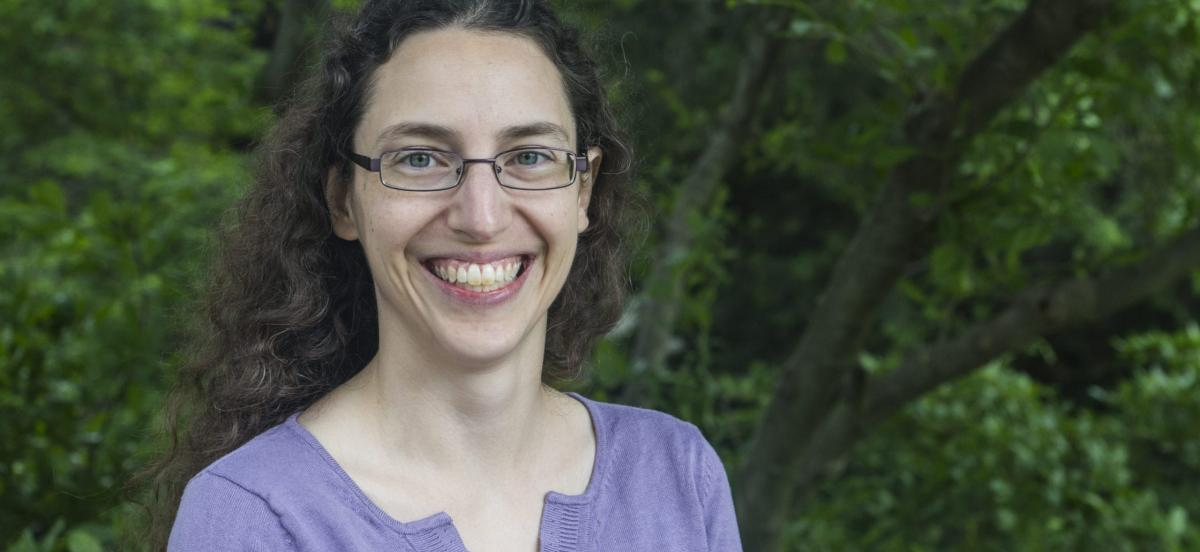 photo of Sarah Horowitz, smiling, standing in front of a tree