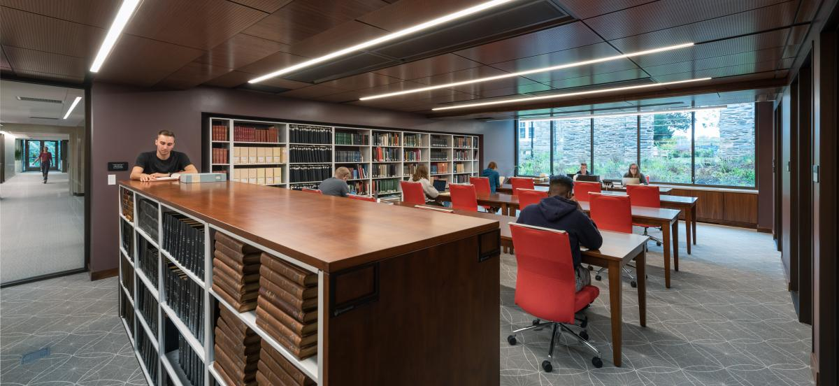 photo of the Quaker & Special Collections reading room, where several people are looking at materials and working