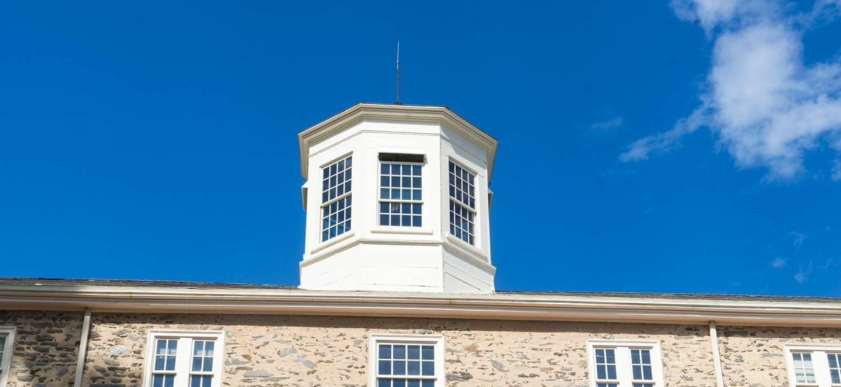 A beautiful blue sky behind the cupola on Founders Hall