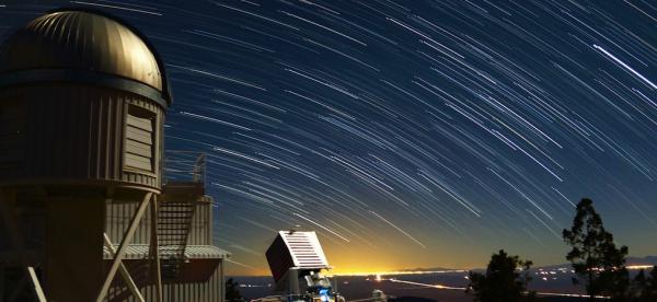 Photo of stars smeared across the night sky using exposure