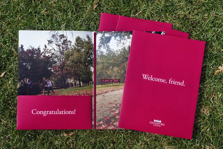 Welcome Friend folders strewn across a grassy lawn